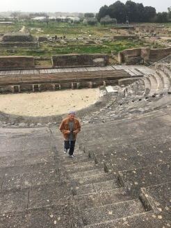Paul walking up the steps of an ancient ruin